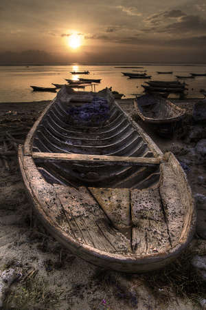 Old fishing boats in the sand in Nusa Lembongan