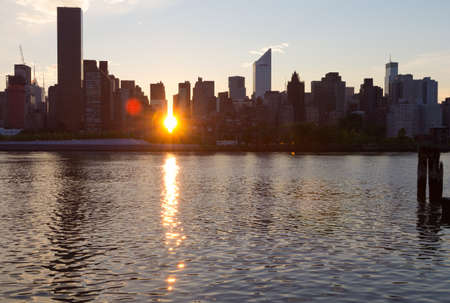 Setting sun shining through the buildings in Manhattan, New York