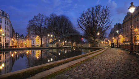 on the canal: Bridge over canal Saint Martin at night in Paris in Winter