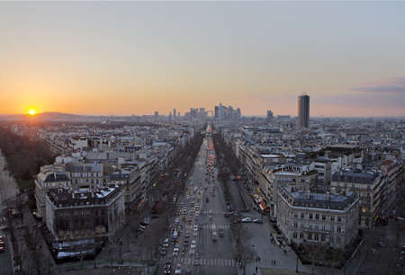 View of Paris and business district at sunset