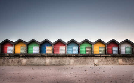Line of wooden, colourful beach huts in Tynemouth