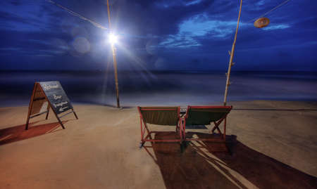 Chairs on Phu Quoc beach at blue hour in Vietnam