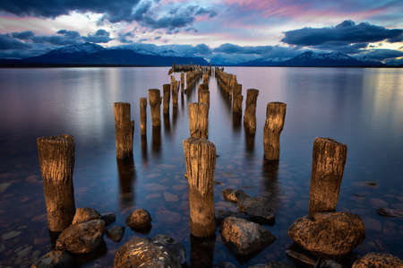 Pink sunset in Chile, Patagonia with a broken pier Stock Photo