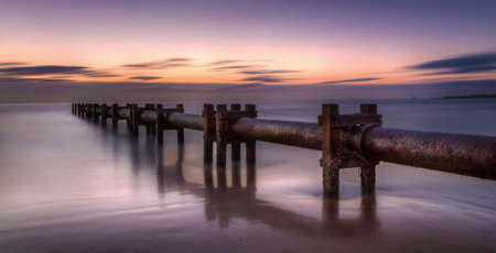 Pipes in the sea at the beach in Blyth