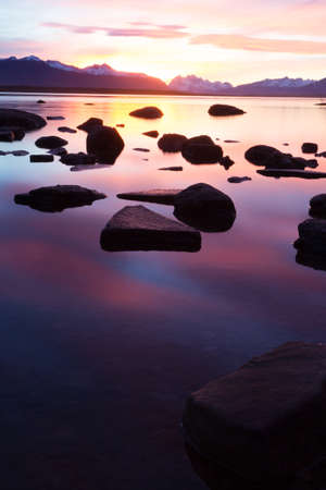 Rocks in Puerto Natales lake at sunset