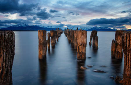Sunset in Chile, Patagonia with a broken pier