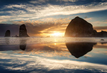 Rocks at sunset on Cannon beach, Oregon Coast photo