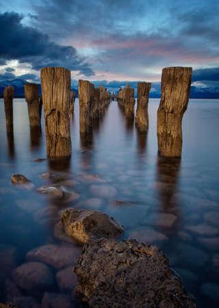 Through a broken pier at sunset, Chile Patagonia