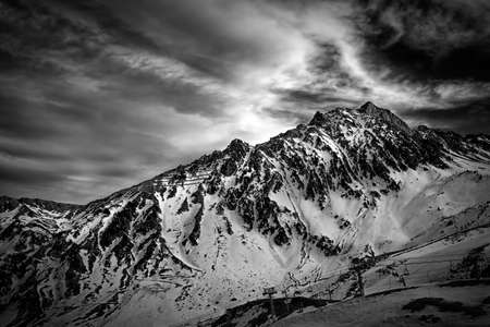 Snowy, jagged mountain in black and white in the Pyrenees Stock Photo - 22508778