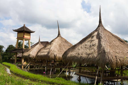 Wooden restaurant huts overlooking the rice paddies in Ubud, Bali