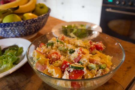 Vegetable couscous in a bowl on the kitchen table