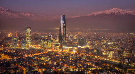 santiago: View of Santiago city at night  with the Andes mountain range
