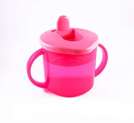 Pink baby cup on a white background Stock Photo