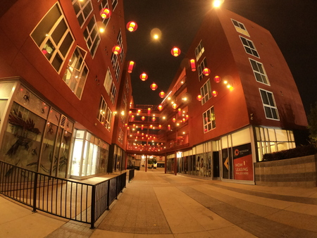 going throw red buildings at night with red asian lights 写真素材