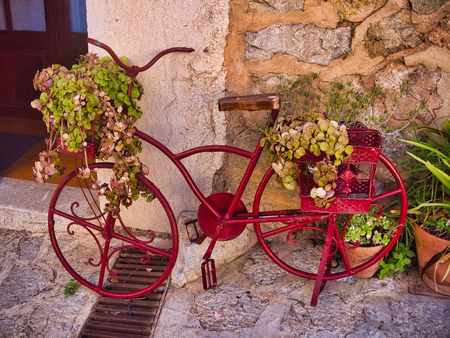 beauty small village in mallorca, called Valldemosa, nice flowers, red bike and cute buildings.