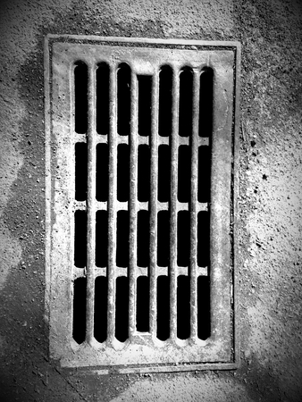 metal grate: Black and white sewer grate