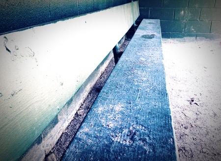 dugout: Cold empty baseball dugout