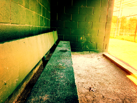 baseball dugout: Warm empty baseball dugout