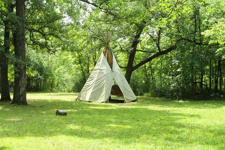 tepee: Te-pee of American Indians usually made of animal skins placed on a conical frame of long poles.