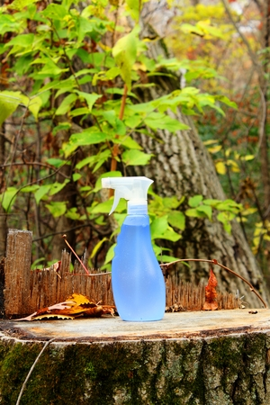 Environmentally Safe liquid cleaner concept with a nature background. Imagens