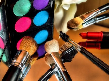 Eye shadow makeup palette with brushes and red lip stick. Stok Fotoğraf