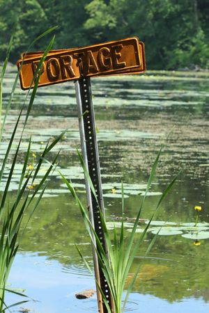 canoeist: Portage sign designating area for canoeist to enter water.
