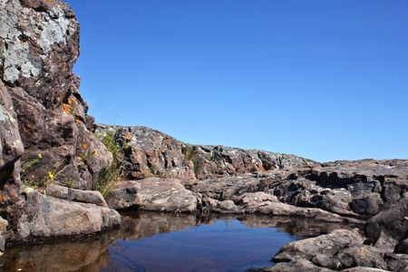rock formation: Rock formation with pool of water from Lake Superior. Stock Photo
