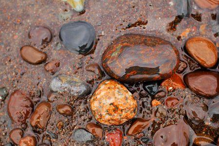 superiors: Colorful wet rocks at Lake Superiors shoreline.