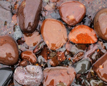 north shore: Large colorful stones at Minnesotas North Shore of Lake Superior. Stock Photo