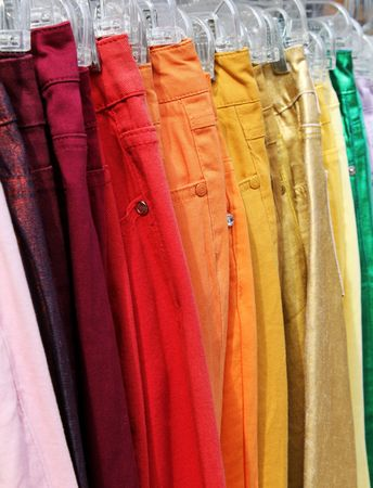hangers: Colorful jeans on hangers. Stock Photo