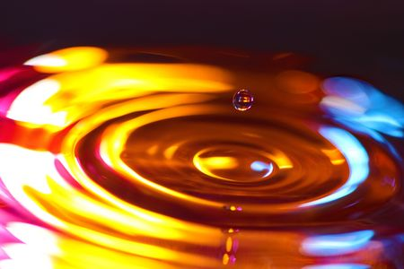 circular water ripple: Vibrant gold with pink water droplet and ripples.