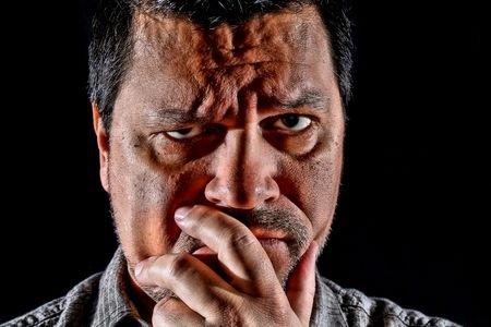 stumped: Close up headshot of man in deep thought. Stock Photo