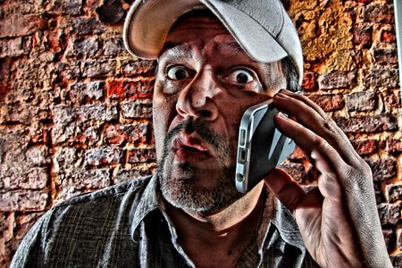 stumped: Surprised man on cell phone. Stock Photo