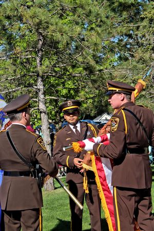 sheriffs: Dakota County Sheriffs Honor Guard prepares the flags for presentation during Law Enforcement Appreciation Day. Editorial