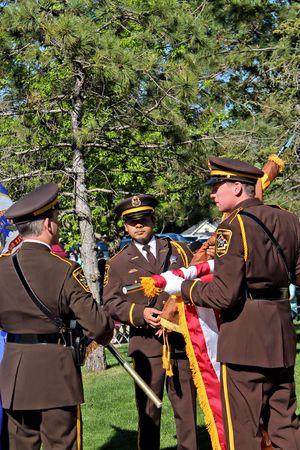 sheriffs: Dakota County Sheriffs Honor Guard prepares the flags for presentation during Law Enforcement Appreciation Day. Editorial