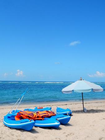 kayak and umbrella on beach photo