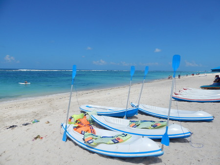 white kayaks and blue paddles Stock Photo