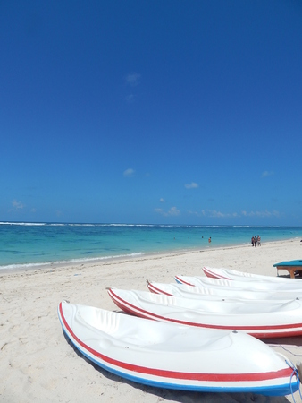 clear blue sky and kayaks