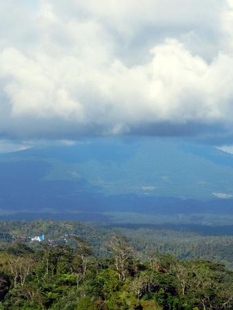 celebes: Cumulonimbus cloud, rain forest and mountain