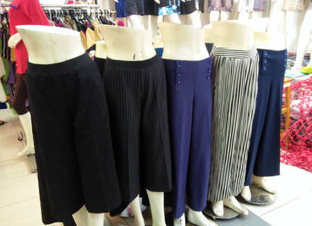 Model of women skirts on mannequins are displayed in front of the retail shop.