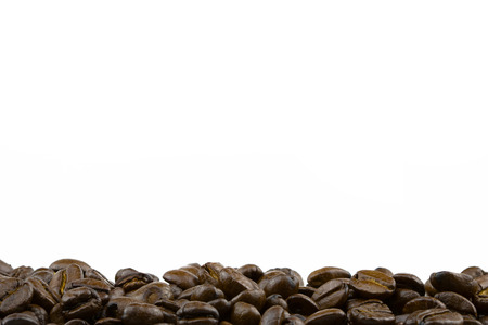 Row of roasted coffee beans with white background 스톡 콘텐츠