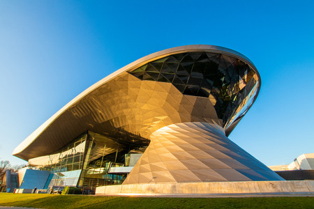 BMW Welt (BMW World), munich, germany - November 17 2018: the BMW Welt in munich at the golden hour with a beautiful sky Standard-Bild - 115967289