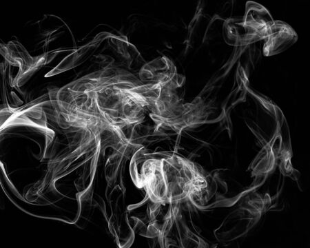 Mystery dense smoke over black background, abstract photo Stockfoto