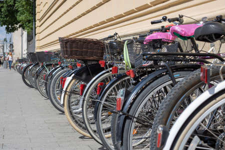 Many bikes on the street - side view