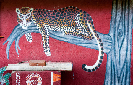 MUMBAI, INDIA – August 9 2018: Leopard painted on the wall of a Warli big-cat temple. Warli are indigenous tribal people. They live at SGNP in harmony with big cats, revering and worshipping th