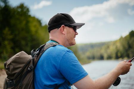 waders: El hombre pesca con mosca en el r�o Ste-Anne, Quebec.
