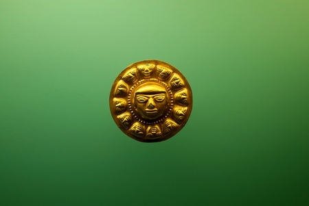 A Pre-Columbian golden face from Colombia Stock Photo