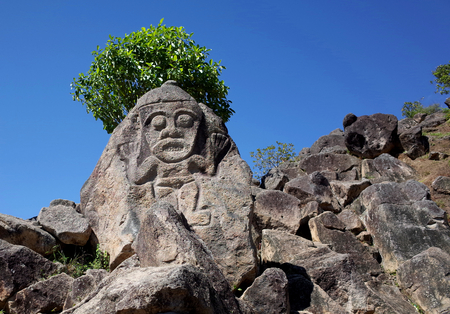An ancient rock carving looks out over the valley near San Agustin Archeological Park in Colombia