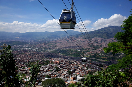 NOV 28TH 2014, MEDELLIN, COLOMBIA - The Medellin Cable Car climbs up from the city center connecting people from a poor community previously trapped by gang and drug violence.