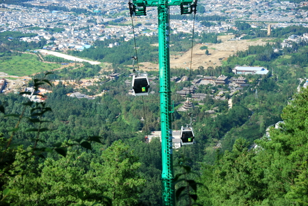 Cable cars carry people to the summit of Mount Cangshan in Dali, Yunnan, China